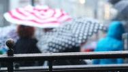 Stock Video Footage of Rainy Day London _ busy street scene crowd of people passing with umbrellas,.
