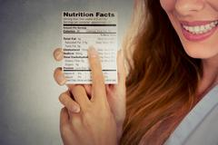 woman reading healthy food nutrition facts - stock photo