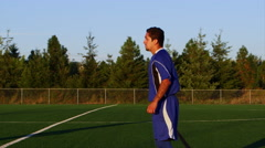 A soccer player does a bicycle kick at sunset Stock Footage