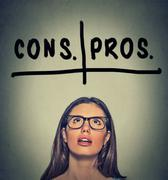 pros and cons, for and against argument concept - stock photo