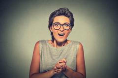 happy young woman looking excited surprised in full disbelief it's me? - stock photo