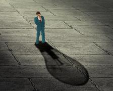 Stock Illustration of Brainstorming businessman concept. Man with his shadow in a shape of lightbul