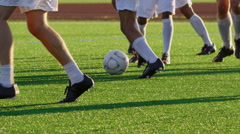 Close up of soccer players' feet during a game Stock Footage
