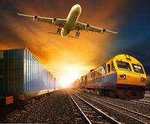 Industry container trainst running on railways track and cargo freight plane  Stock Photos