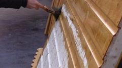 Carpenter painting wood Stock Footage