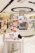 Women Luxury Cosmetics On Store Stand - stock photo