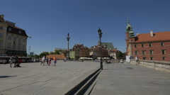 Tourists walking in the Castle Square of Warsaw Stock Footage