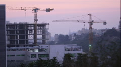 Cranes at a construction site Stock Footage