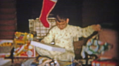 1954: Boy gets boring flannel shirt for Christmas gift. Stock Footage