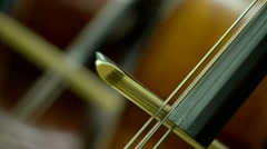 Strings and bow on a cello Stock Footage