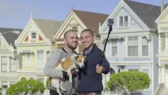 Gay Couple Pose With Their Dog, In Front Of Painted Ladies, For Gopro Selfies Stock Footage
