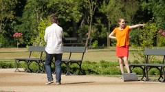 Couple walking and taking pictures in a park, Warsaw Stock Footage