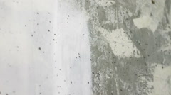 Paint the white concrete wall with a brush Stock Footage
