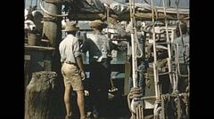 Vintage 16mm film, 1956, Key West, turtle boat, dragging turtle - stock footage