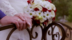 Wedding bouquet in hands of the bride and groom Stock Footage