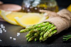 Bunch of fresh asparagus stems - stock photo