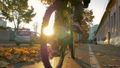 Slowmotin bicycle in city sunset Stock Footage