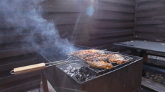 Chiken meat on barbeque grill Stock Footage