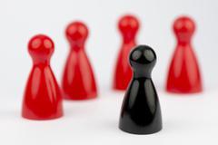 Conceptual game pawns. Stock Photos