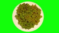 4k – Bunches of green grapes on plate Stock Footage