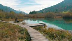Stock Video Footage of Beautiful green autumn lake, wide shot