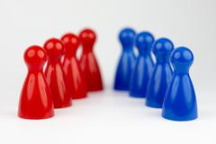 Conceptual game pawns. - stock photo