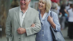 4K Portrait of happy mature couple outdoors in the city Stock Footage