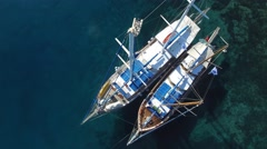 Two gulets moored to the shore Stock Footage