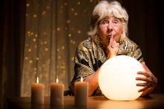 Telling fortune from magic ball - stock photo