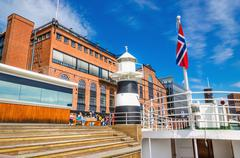 Aker Brygge in Oslo and lighthouse, Norway - stock photo