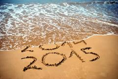New Year 2015 is coming concept - inscription 2014 and 2015 on a beach sand,  Stock Photos