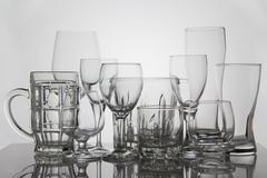 Drink glasses on white background - stock photo