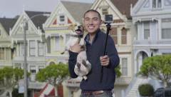 Man Poses (For Gopro Photos) With His Dog In Front Of Painted Ladies Stock Footage