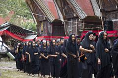 Women procession at a traditional funeral Stock Photos