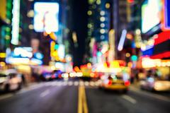 Blurred street llumination and night lights of New York City Kuvituskuvat