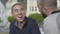 Closeup Of Couple Laughing And Eating, They Talk To Friends Off Screen Stock Footage