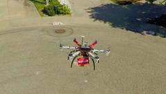 An aerial point of view of a drone delivery service. - stock footage