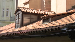Red roof with window in Prague Stock Footage