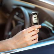 hand holding remote car key - stock photo