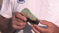 Man holds a beautiful piece of Opal found in northern Nevada Stock Footage