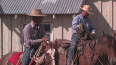 Cowboys get ready to rope cattle in northern Nevada Stock Footage