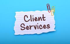 Client Services handwrriten on Paper closeup Stock Photos