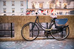 Traditional classic bicycle near water canal Stock Photos