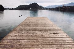Wooden pier at the lake water.. - stock photo