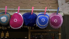 Selling crochet Jewish hats in Prague Stock Footage