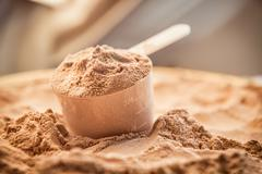 Whey protein scoupe. Sports nutrition. Stock Photos