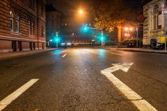 Empty night road with traffic lights - stock photo
