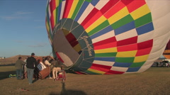Heat from flames fill a hot air ballon Stock Footage
