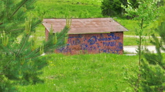 Bus Stop with Graffitti in Abandoned Village Stock Footage