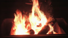 A campfire warms with flickering flames Stock Footage